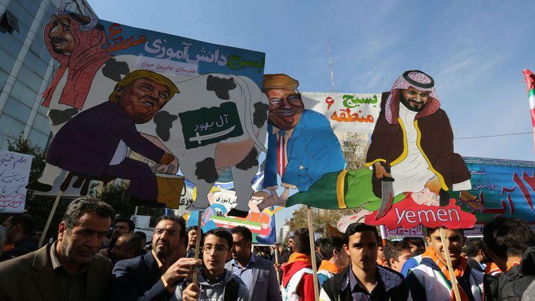 Protesters mock President Donald Trump, Saudi Arabia's King Salman and Crown Prince Mohammed bin Salman