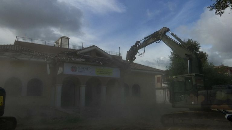 Italian minister helps bulldoze mafia house