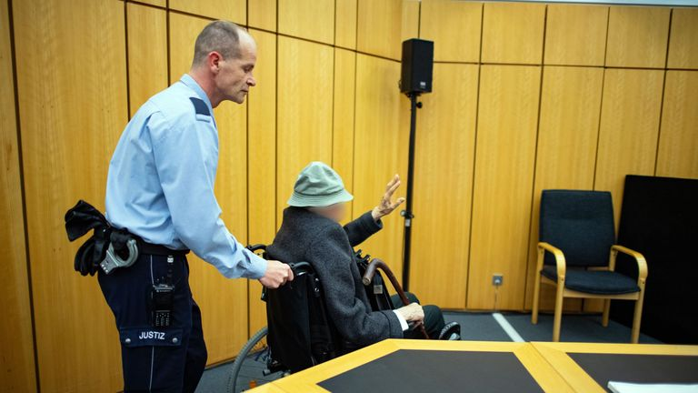 Former SS guard, Johann Rehbogen was pushed into court in a wheelchair