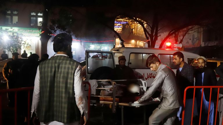 Afghan health workers carry an injured person after a suicide attack targeted a wedding hall, in Kabul. Pic: JAWAD JALALI/EPA-EFE/REX/Shutterstock