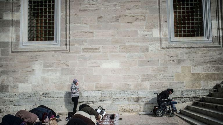 People pray outside after a symbolic funeral prayer for Saudi journalist Jamal Khashoggi