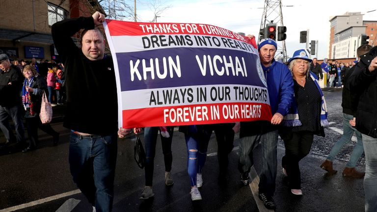 Fans hold a flag thanking the chairman for making dreams a reality