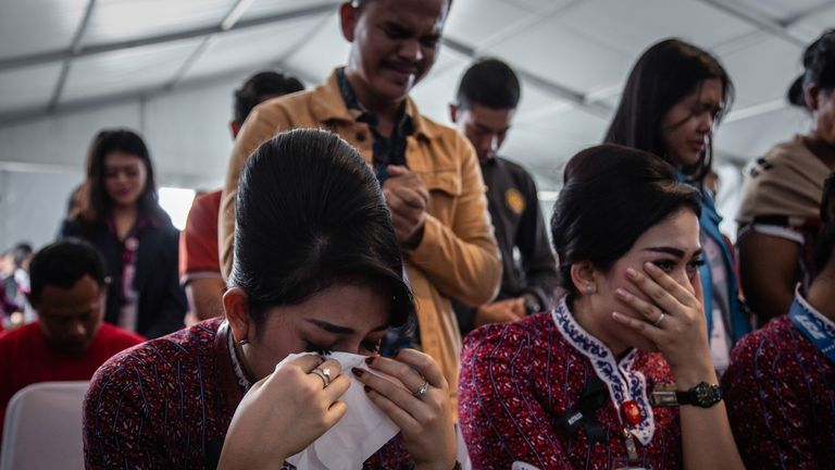 KARAWANG, INDONESIA - NOVEMBER 06: Families and colleagues of victims of Lion Air flight JT 610 cry on deck of Indonesian Navy ship KRI Banjarmasin during visit and pray at the site of the crash on November 6, 2018 in Karawang, Indonesia. Indonesian investigators said on Monday the airspeed indicator for Lion Air flight 610 malfunctioned during its last four flights, including the fatal flight on October 29, when the plane crashed into Java sea and killed all 189 people on board. The Boeing 737