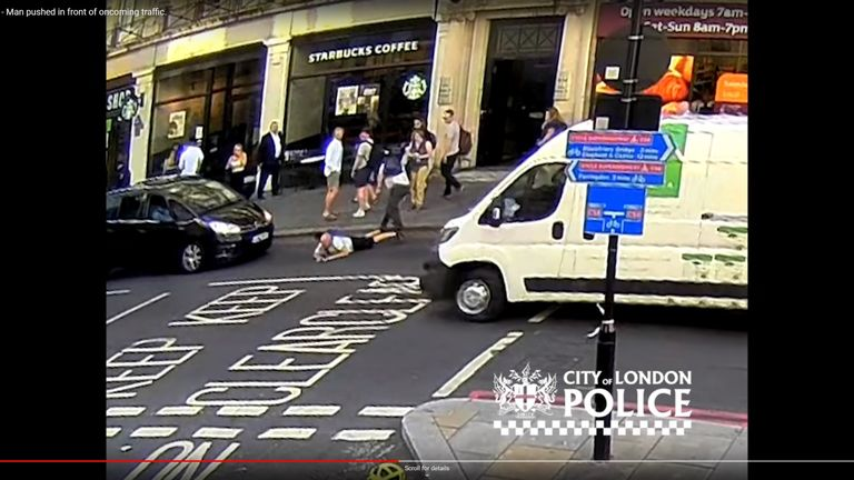 Cctv Shows The Man Being Shoved Into Path Of An Oncoming Taxi