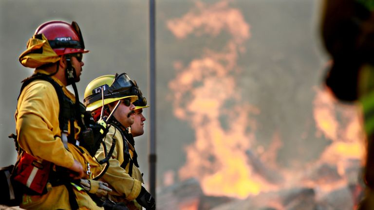 Firefighters battle a blaze at the Salvation Army Camp on November 10, 2018 in Malibu, California