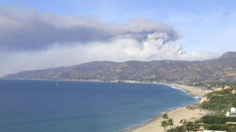 A massive billowing plume of smoke is clearly visible from the wildfires in  Malibu as it drifts out to sea