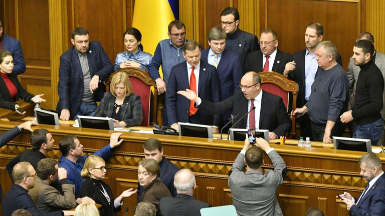 Ukrainian MPs argue with Parliament Speaker Andriy Parubiy ahead of the vote