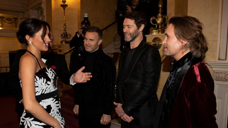Meghan, the Duchess of Sussex, meets members of Take That at the Royal Variety Performance in London
