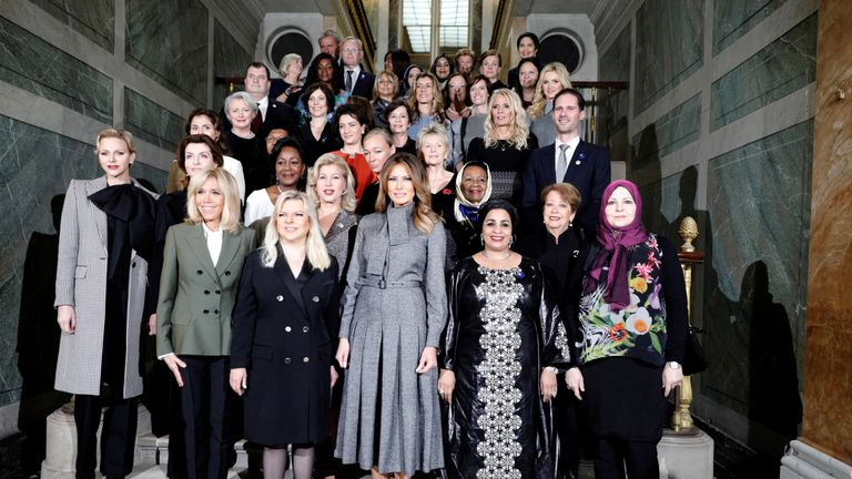 Mrs Trump with leaders' partners in Paris last week