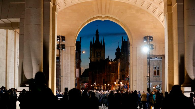 People attend a special edition of the Last Post ceremony at the Commonwealth War Graves Commission Ypres Memorial at the Menenpoort in Ieper (Menin Gate, Ypres) on November 11, 2018 on the occasion of the 100th Armistice Day marking the end of World War I