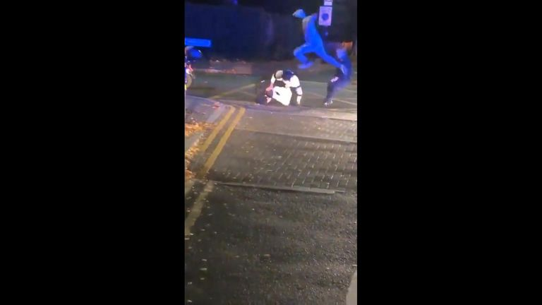 A suspect kicks one officer in the chest