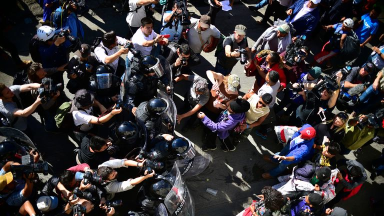 Several hundred migrants push past a blockade of Mexican police