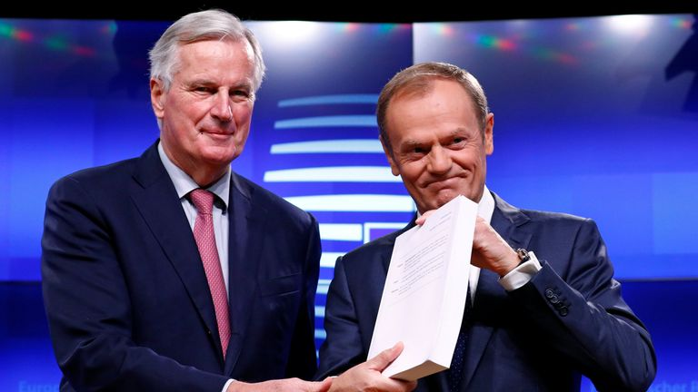 European Union's chief Brexit negotiator Michel Barnier and European Council President Donald Tusk pose with the Brexit draft text