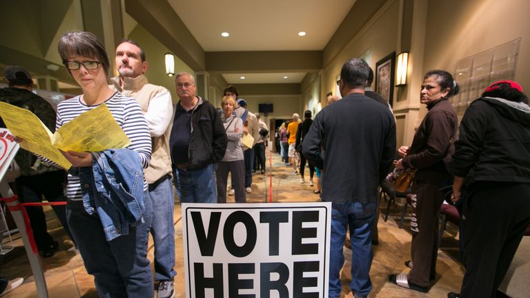 Voters line-up to cast their ballots at a polling station in Marietta, Georgia