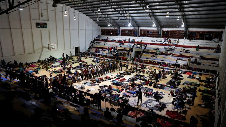 The migrants have been given shelter at a sports centre in Arriaga, Mexico