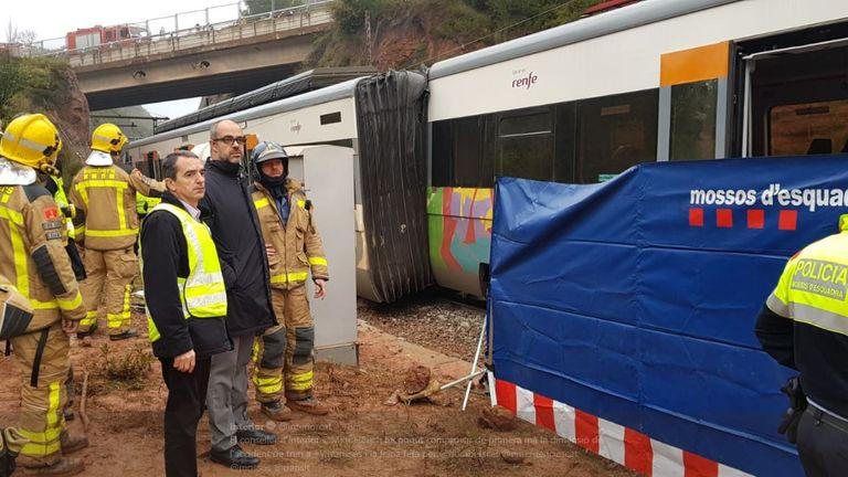 Interior minister Miquel Buch inspects the scene of a derailed train. Pic: Catalonia Interior Ministry