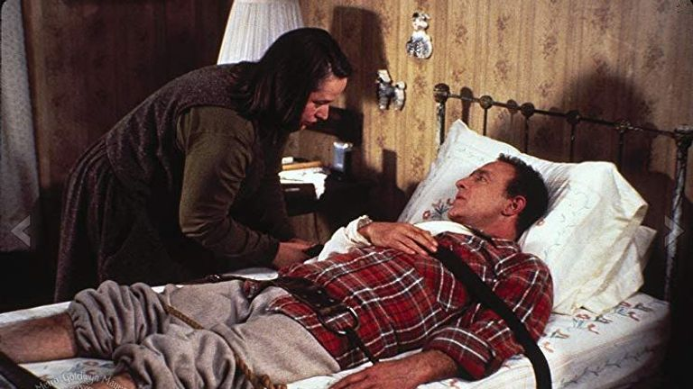 Kathy Bates and James Caan in Misery, written by Stephen King, screenplay by William Goldman