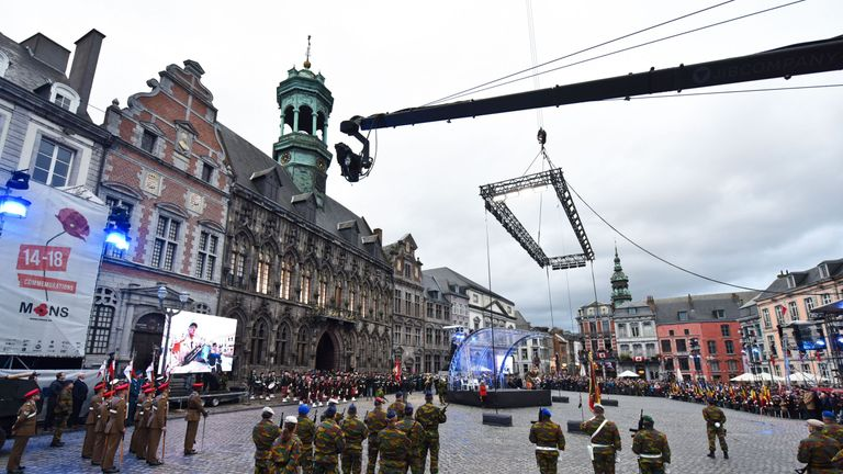 People attend a World War I ceremony in Mons, Belgium, on November 11, 2018 as part of commemorations marking the 100th anniversary of the 11 November 1918 armistice, ending World War I