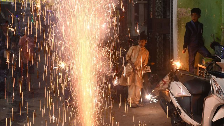 Children watch firecrackers during the celebrations