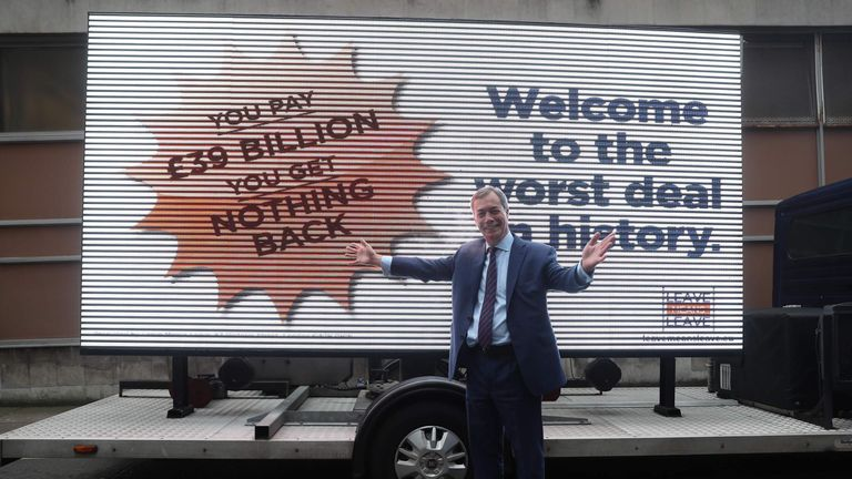 Nigel Farage, vice chairman of pro-Brexit campaign group Leave means Leave poses by a billboard that criticizes the EU divorce deal agreed by British Prime Minister Theresa May on November 27, 2018 in London. (Photo by Daniel LEAL-OLIVAS / AFP) (Photo credit should read DANIEL LEAL-OLIVAS/AFP/Getty Images)