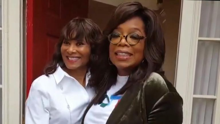 Oprah Winfrey surprises a voter while canvassing for Democrat candidate Stacey Abrams in Georgia
