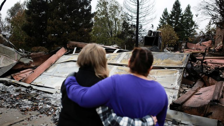 People survey the damage from the fires in Paradise