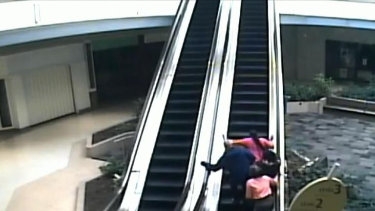Suspects charge over a child on an escalator after allegedly stealing perfume