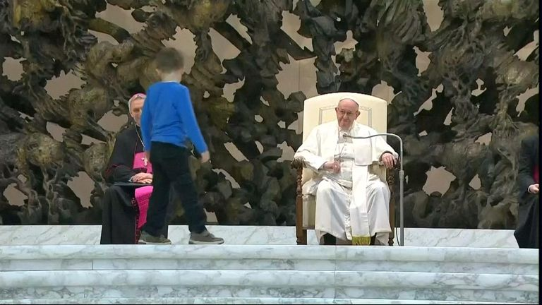 Pope Francis praised the freedom, albeit undisciplined, of a hearing-impaired child who climbed onto the stage to play around him.