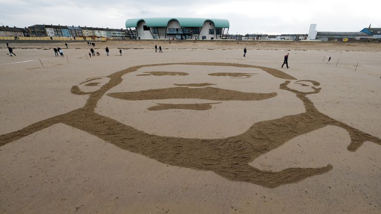 The image of Private Theophilus Jones, from Darlington is etched into the sand on Redcar beach