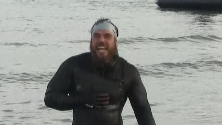 Ross Edgley emerges from the water at the end of his marathon swim