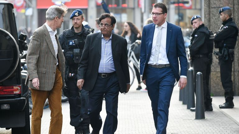 Pakistani lawyer Saiful Mulook (C), escorted by the police, arrives at The Hague after fleeing Pakistan