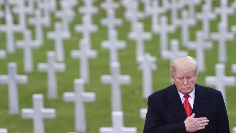 Donald Trump takes part in a US ceremony at the American Cemetery of Suresnes