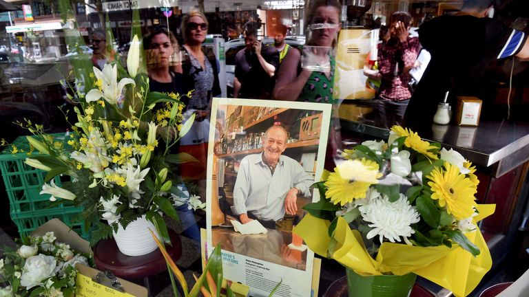 People pay their respects for Sisto Malaspina, who was killed November 9 in a stabbing attack, outside Pellegrini's Espresso Bar in Melbourne on November 10, 2018