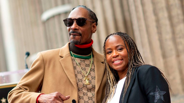 Rapper Snoop Dogg with his wife Shante Broadus attend the ceremony honoUring Snoop Dogg with a star on Hollywood Walk of Fame