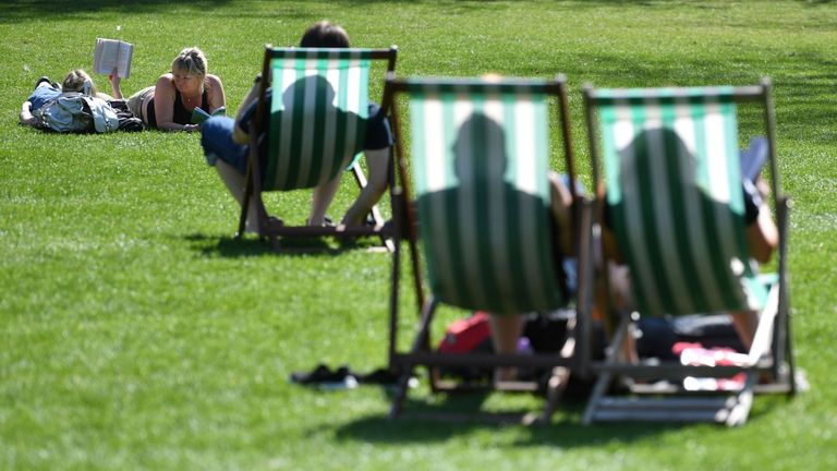 People enjoy the sun in St James's Park in central London on April 9, 2017