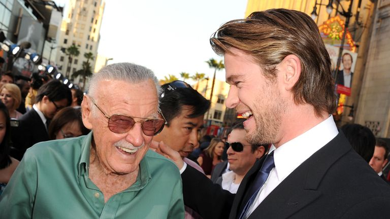 Stan Lee with actor Chris Hemsworth at the premiere of Thor in 2011
