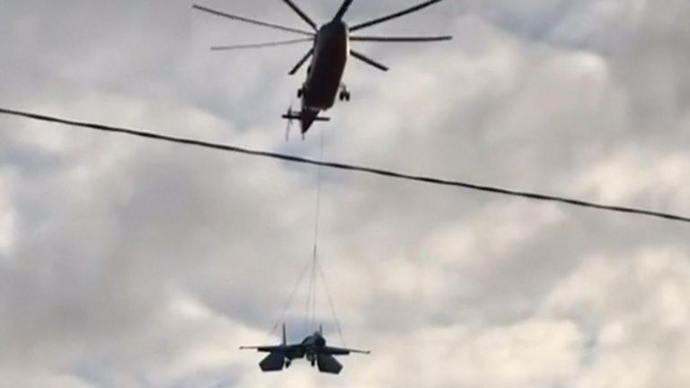 Helicopter transports Sukhoi Su-27 fighter from airfield to St Petersburg