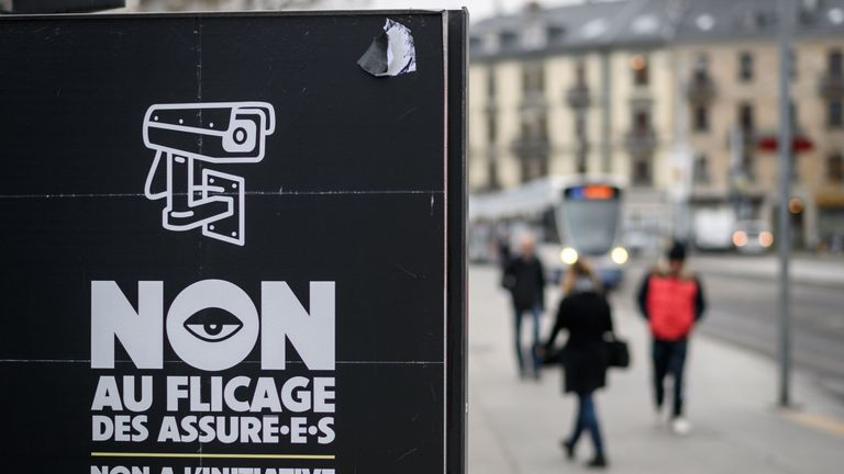 A campaign poster reading in French 'No to the policing of the people covered by insurance'