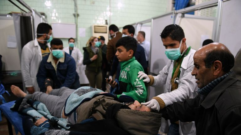 A Syrian man is brought in for treatment at a hospital in Aleppo after what official Syrian media called a gas attack