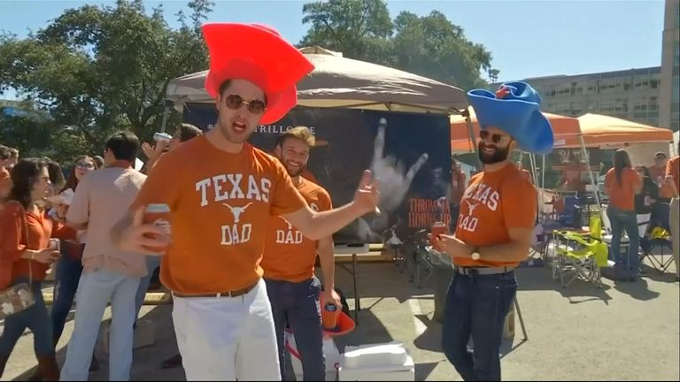 While Texas football fans may have mixed views on who to support for the U.S. Senate, they found common cause supporting their home team as Republican Senator Ted Cruz remains in a close race with Democratic challenger Beto O'Rourke.