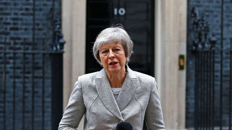 Theresa May addresses the media