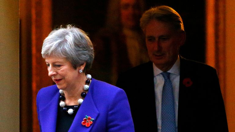 Britain's Prime Minister Theresa May and Chancellor of the Exchequer Philip Hammond leave 10 Downing Street.