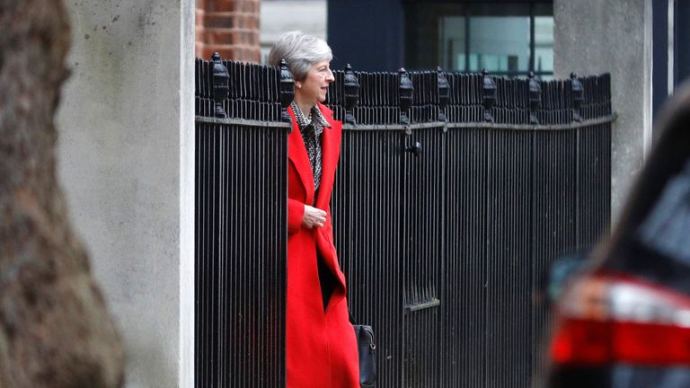 Theresa May leaves 10 Downing Street via the back exit