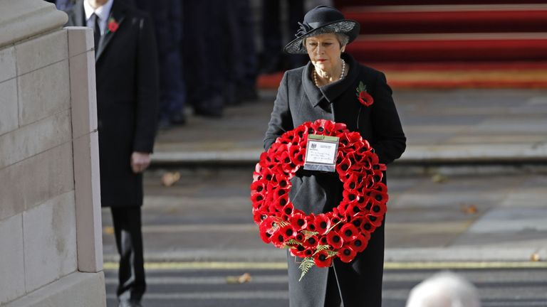 Theresa May lays a poppy wreath at the Cenotaph