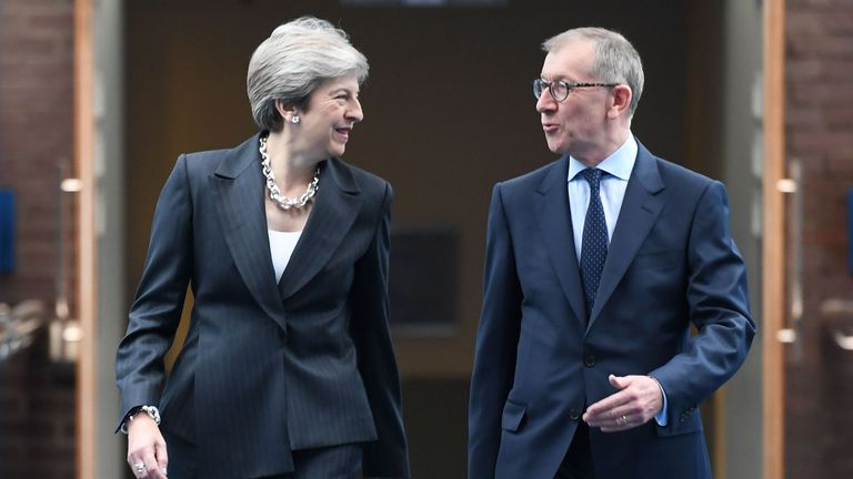 Britain's Prime Minister Theresa May (L) arrives with her husband Philip May (R) from the hotel to the International Convention Centre in Birmingham,