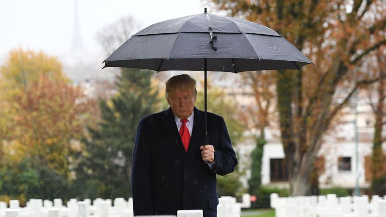 US President Donald Trump closes his eyes as he visits the American Cemetery of Suresnes, outside Paris, on November 11, 2018 as part of Veterans Day and the commemorations marking the 100th anniversary of the 11 November 1918 armistice, ending World War I