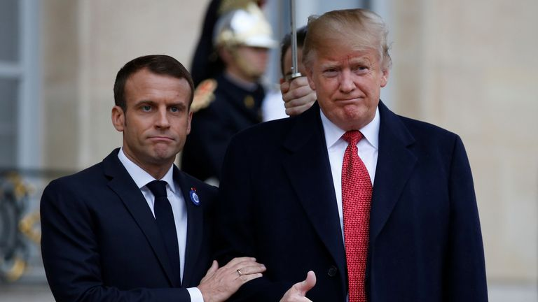 French President Emmanuel Macron welcomes U.S. President Donald Trump at the Elysee Palace on the eve of the commemoration ceremony for Armistice Day, 100 years after the end of the First World War, in Paris, France.