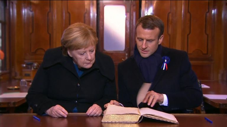 Mr Macron and Ms Merkel in the railway carriage where the Armistice was signed