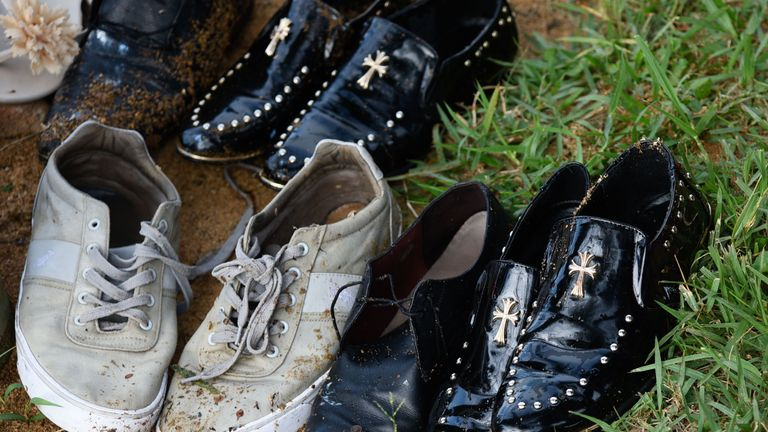 Shoes recovered at the rescue site of capsized cruise boat on Lake Victoria