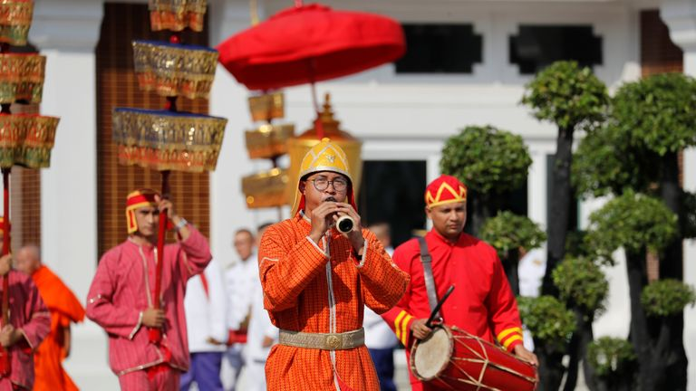 Royal soldiers attend a procession at the temple where the funeral of Vichai Srivaddhanaprabha
